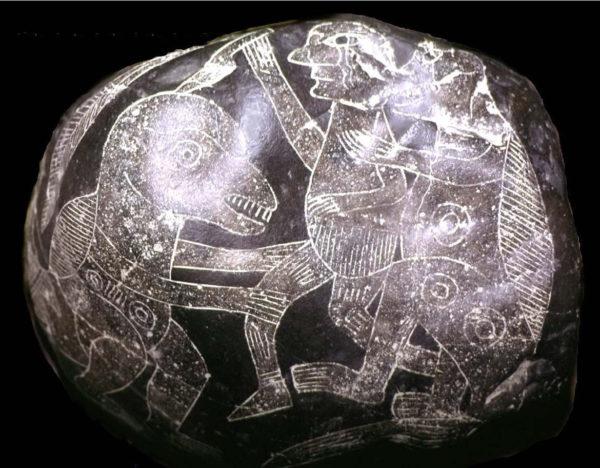 Una delle pietre di Ica. Un uomo si difende dall'attacco di due dinosauri di piccola taglia (1)